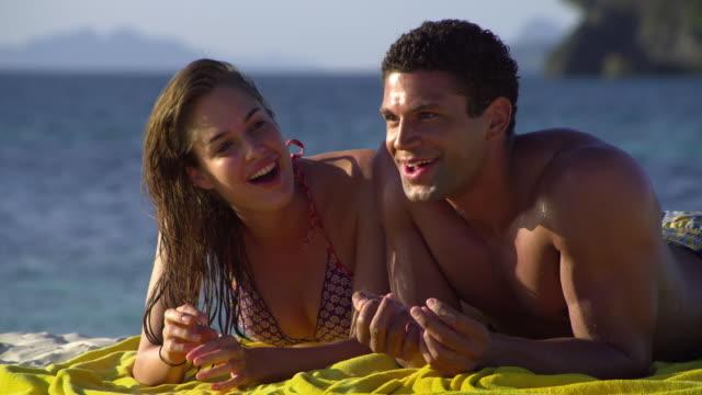 cu happy young couple relaxing on tropical beach, krabi, thailand - provinsen krabi bildbanksvideor och videomaterial från bakom kulisserna
