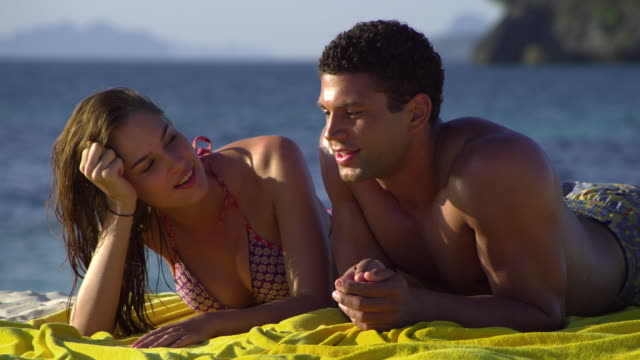 cu happy young couple relaxing on tropical beach, krabi, thailand - handtuch stock-videos und b-roll-filmmaterial