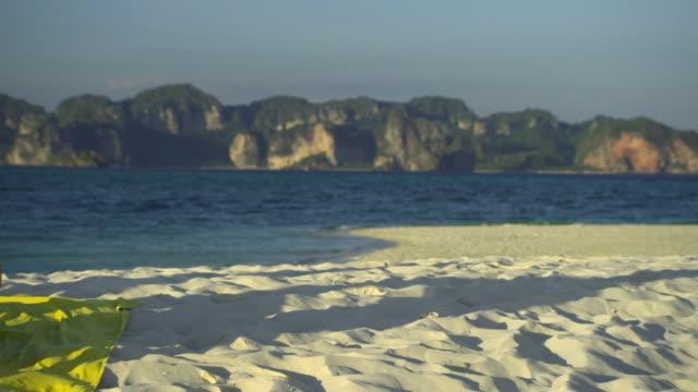 ms pan happy young couple relaxing on tropical beach, krabi, thailand - 水泳パンツ点の映像素材/bロール