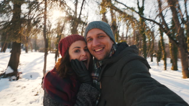happy young couple taking a selfie. - couple relationship photos stock videos & royalty-free footage