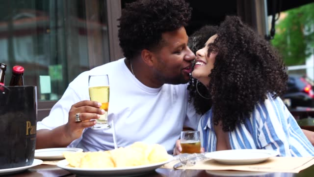 happy young couple toasting with beer in a bar - pardo brazilian stock videos & royalty-free footage