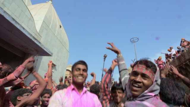 Happy young, dancing people at Holi Festival, India