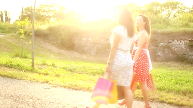 happy young friends walking with shopping bags - full length stock videos & royalty-free footage