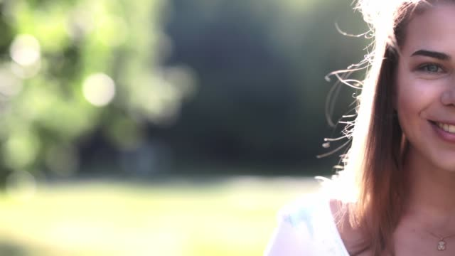 happy young girl in the park - close-up portrait - hd video - video portrait stock videos & royalty-free footage