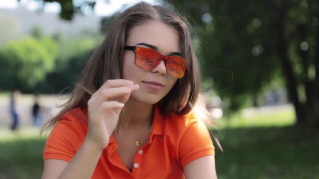happy young girl in the park - portrait with glasses - hd video - video portrait stock videos & royalty-free footage