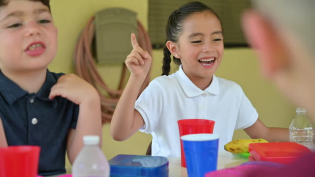 happy young girl laughing ad smiling at lunch - school dinner stock videos & royalty-free footage