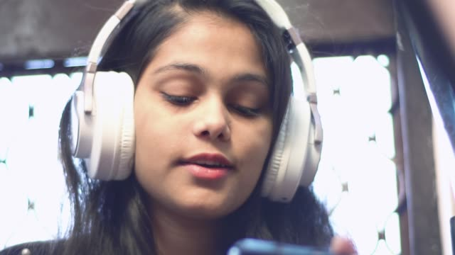 happy young girl listening music with headphones - one teenage girl only stock videos & royalty-free footage