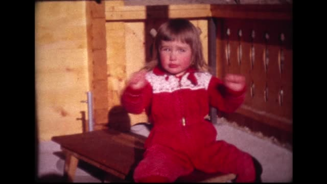 1963 happy young girl sitting on bench waving her arms - jumpsuit stock videos and b-roll footage