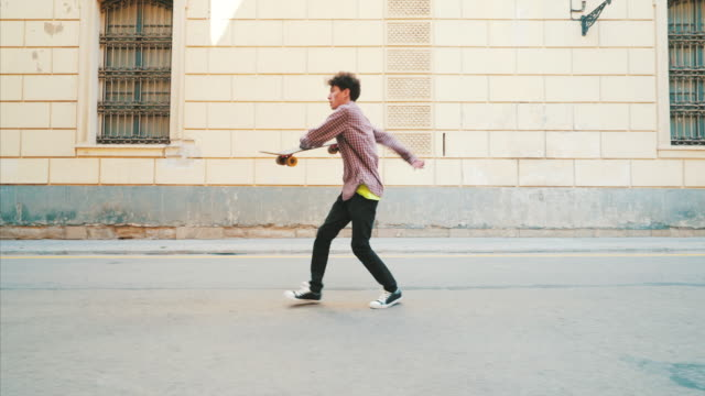 happy young man dancing on the streets. - uomini video stock e b–roll