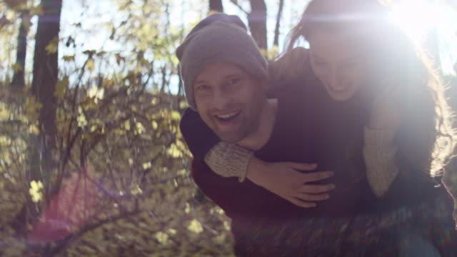 Happy young man piggybacking his girlfriend