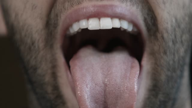 happy young man showing his tongue into the camera - sticking out tongue stock videos & royalty-free footage