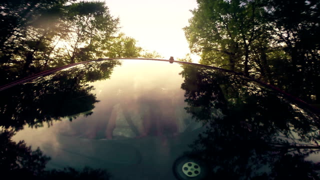 happy young men riding a car - honeymoon stock videos & royalty-free footage