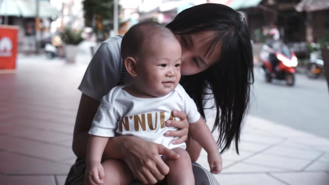happy young mother holding her baby son - 6 11 months stock videos & royalty-free footage