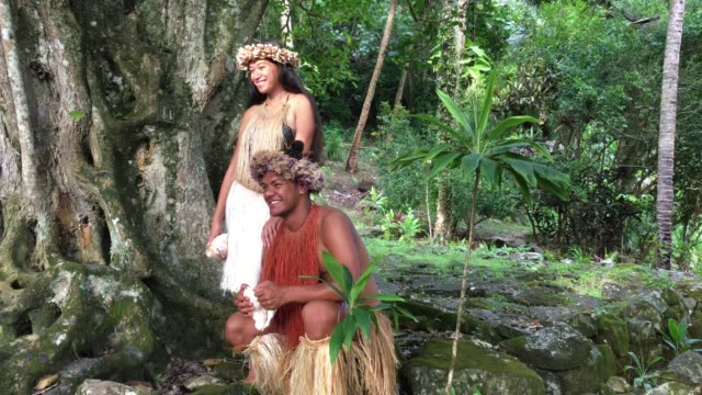 happy young pacific islander couple in a ancient maori marae in the highlands of rarotonga, cook islands - pacific islander stock videos & royalty-free footage