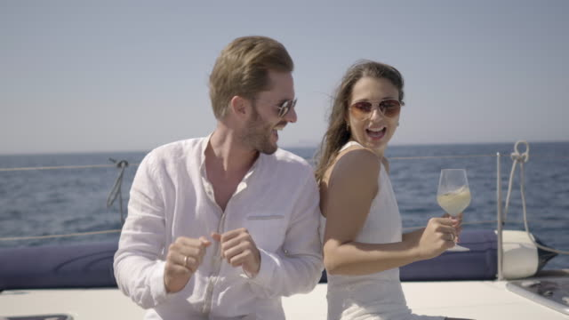 happy young rich couple dancing on yacht - dancing back to back stock videos & royalty-free footage