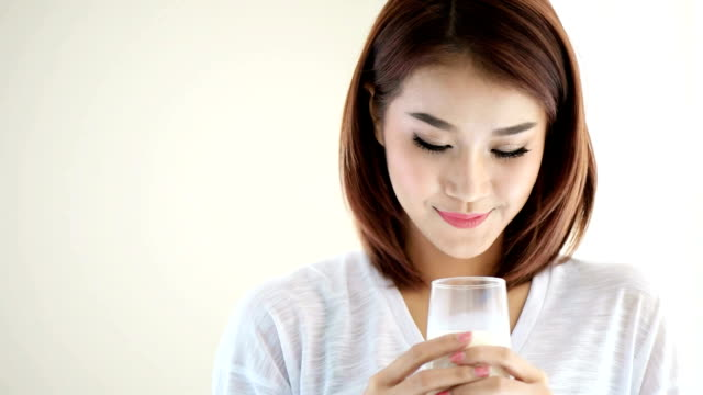 happy young woman drinking milk - milk tea stock videos & royalty-free footage