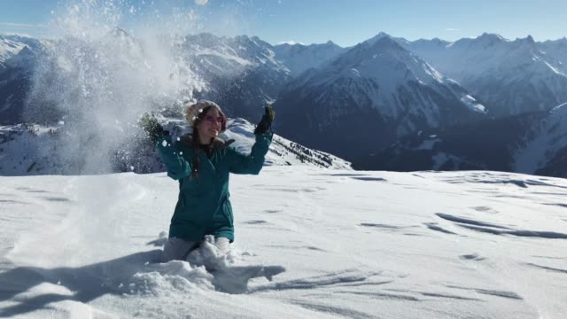 happy young woman enjoying winter season in the mountains - arms outstretched stock videos and b-roll footage