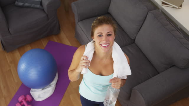 Happy young woman smiling after exercising