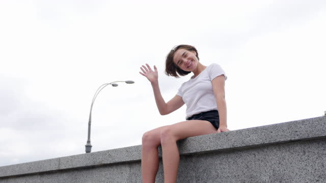 happy young woman smiling - white shirt stock videos & royalty-free footage