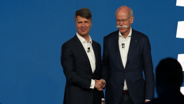 Harald Krüger CEO of BMW AG and Dieter Zetsche CEO of Daimler AG shake hands after speaking to the media about a new joint effort between the two...