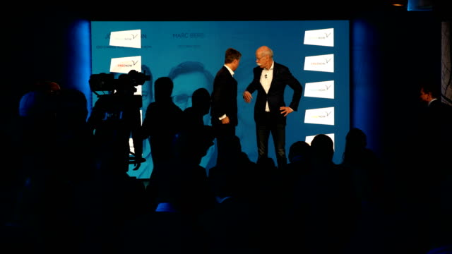 Harald Krüger CEO of BMW AG and Dieter Zetsche CEO of Daimler AG shake hands with other CEOs from each department after speaking to the media about a...