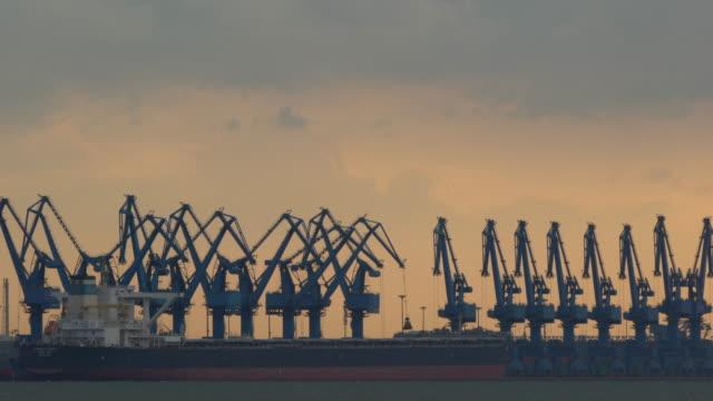 vidéos et rushes de harbor and cloudscape at sunset - bay of water