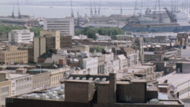 1984 montage harbor and surrounding cityscape of buildings / southampton, england, united kingdom - southampton hampshire stock-videos und b-roll-filmmaterial