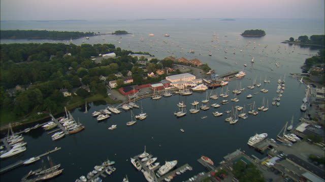 stockvideo's en b-roll-footage met aerial, harbor and town at sunset, camden, maine, usa - maine