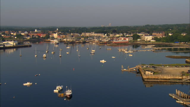 LOW AERIAL, Harbor and town in morning sun, Rockalnd, Maine, USA