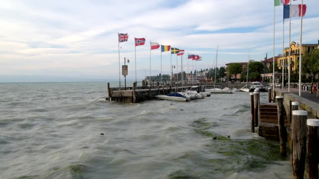harbor entrance of sirmione with strong waves, sirmione, brescia, lake garda, lago di garda, lombardy, lombardei, italy - lago stock videos & royalty-free footage