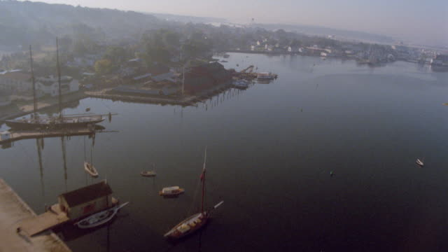 AERIAL harbor + town in New England / Autumn