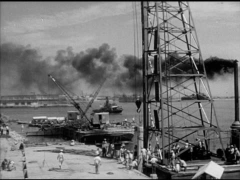 harbor w/ cranes on barges fg tug harbor bg vs men standing under steel structure of pile driver steam hammer w/ beam tu top of machine - pile driver stock videos and b-roll footage