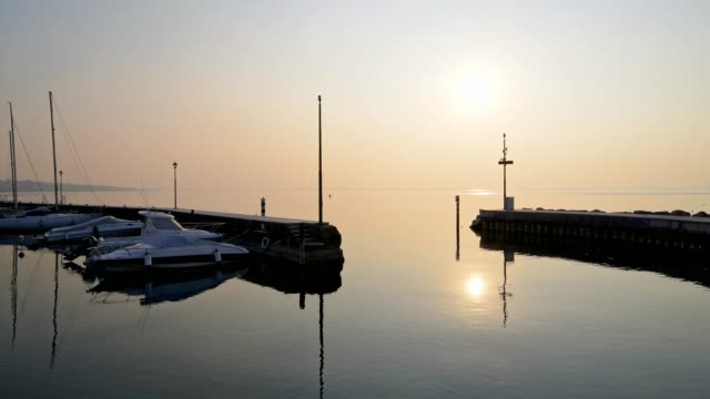 harbor with sailing ships at sunset, lazise, verona, lake garda, lago di garda, veneto, italy - lago stock videos & royalty-free footage