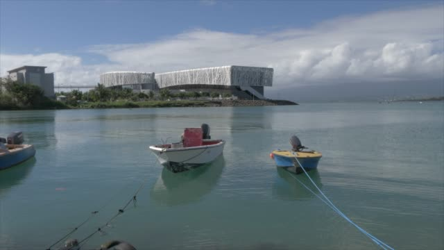 vidéos et rushes de harbour boats and memorial act in background, pointe-a-pitre, guadeloupe, french antilles, west indies, caribbean, central america - guadeloupe