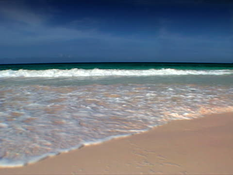 harbour island: sand swirling at pink sands beach - artbeats stock videos & royalty-free footage