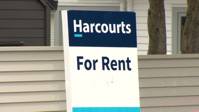harcourts real estate sign on fence advertising property available for rent - real estate sign stock videos & royalty-free footage