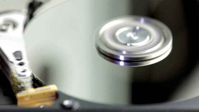 hard disk drive inside closeup - disk stock videos and b-roll footage