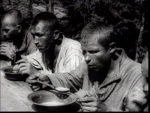 Hard labour camp / gulag in Siberia Lunchtime for the BAM railway workers vs gulag prisoners eating Rations of rye bread Zeks eat soup Pan faces MCU...
