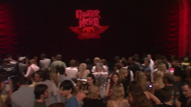 hard rock cafe hosts the launch of the new aerosmith guitar hero at the aerosmith launches new guitar hero at new york ny. - エアロスミス点の映像素材/bロール