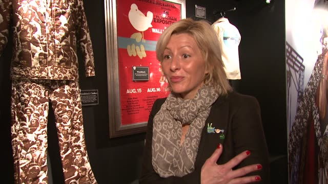 hard rock cafe's director of philanthropy/woodstock memorabilia expert annie balliro on what she thinks made woodstock such a historical event at the... - hard rock cafe stock videos & royalty-free footage