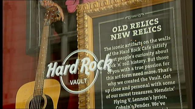 hard rock vault exhibits rock memorabilia england london hard rock cafe ext guitar displayed in front window of the hard rock cafe / entrance to the... - hard rock cafe stock videos & royalty-free footage