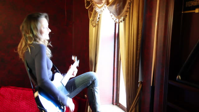 HD: Hard Rocking Woman Performs to Window and Camera, Leaves