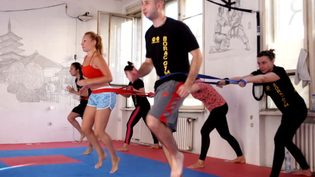 hard work out training - male with group of females stock videos & royalty-free footage