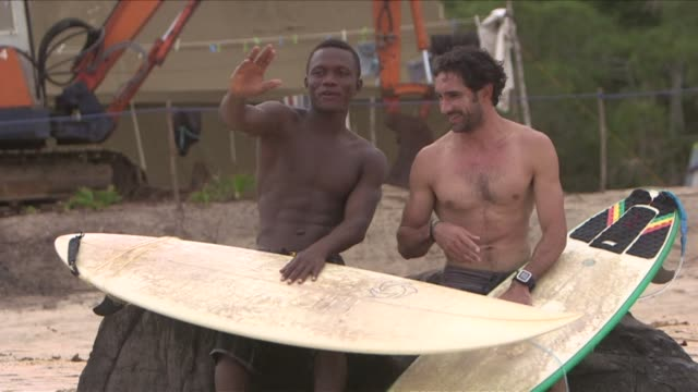 hardcore surfers have known about the world class breaks off the coast of liberias north west coast for years but locals in the poor fishing... - surf fishing stock videos & royalty-free footage