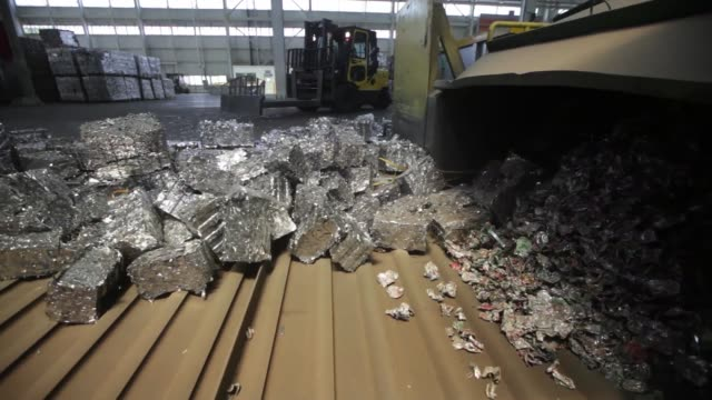 Hardened aluminium bullions are piled in the yard by a forklift truck at the Novelis Inc production facility in Yeongju Bales of crushed aluminum...
