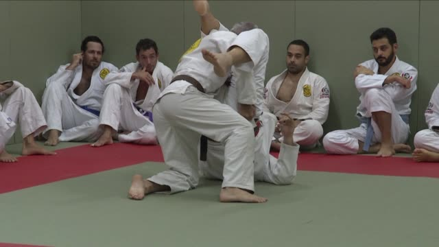 hardened fighters from around the globe beat a path to rio de janeiro's gyms to learn brazilian jiu jitsu a mixed martial art form which has become... - jiu jitsu stock videos and b-roll footage