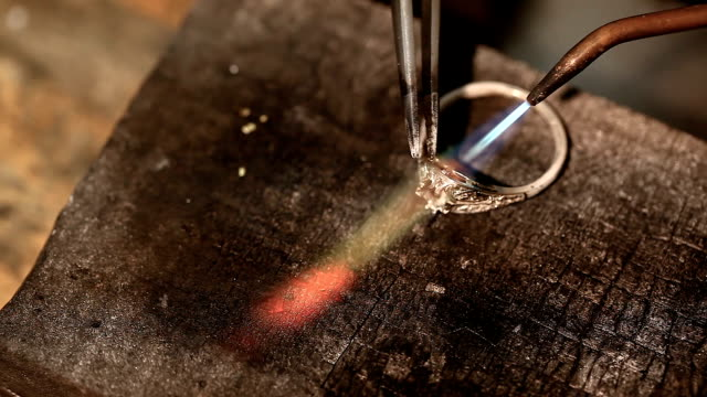 hardening of gold with fire - ring stock videos and b-roll footage