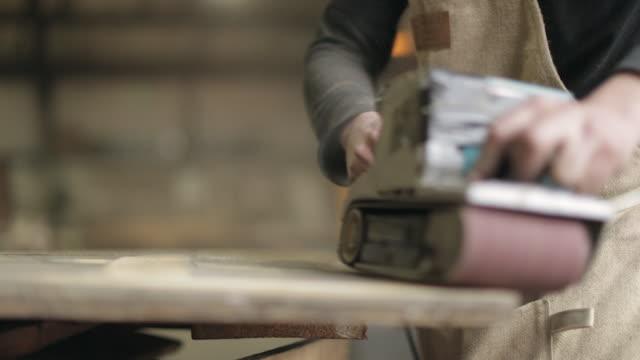 Hardwood Flooring Workshop - Sanding Reclaimed Wood Panelling