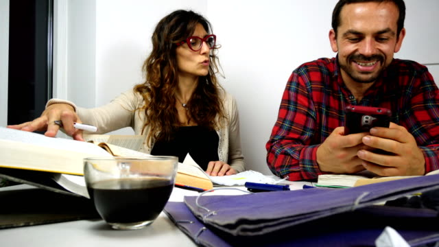 hardworking girl and rude boy study together - colleague stock videos & royalty-free footage