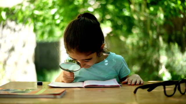 hardworking student - magnifying glass stock videos & royalty-free footage